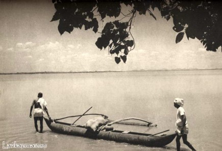 Natives with their canoe, Ceylon by LIONEL WENDT