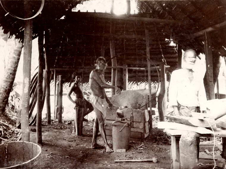 A smithy at work in Ratnapura, Ceylon